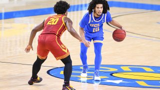The Bruins face the Trojans in a men's basketball game.