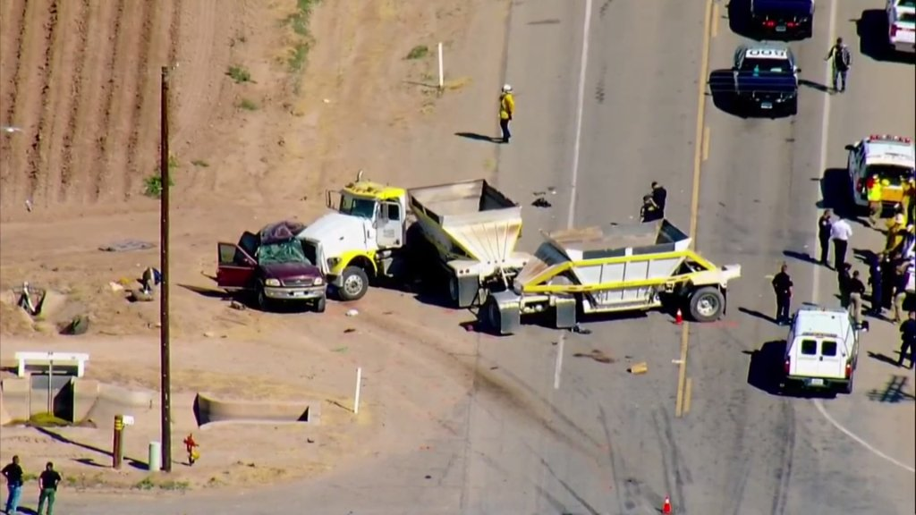 Authorities respond to the scene of a deadly crash involving an SUV and a big rig in Imperial County on Tuesday, March 2, 2021.