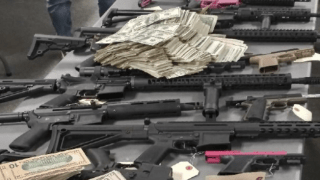 Guns and cash seized from a home in Normal Heights.
