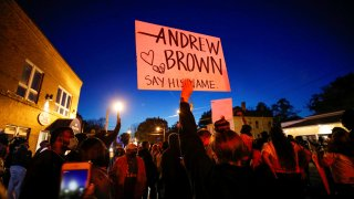 Protesters march in the evening after family members were shown body camera footage of a deputy sheriff shooting and killing Black suspect Andrew Brown Jr. last week, in Elizabeth City, North Carolina, April 26, 2021.