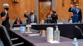 From left, Kiran Ahuja, the nominee to be Office of Personnel Management Director, and the nominees for Postal Service Governors Anton Hajjar, Amber McReynolds, and Ronald Stroman, are sworn in at a Senate Governmental Affairs Committee hybrid nominations hearing on Capitol Hill, Thursday, April 22, 2021, in Washington.