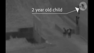 Surveillance cameras capturing the moment a child is from from atop the border wall