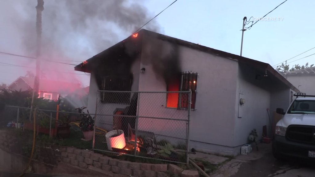 Firefighters were met with heavy smoke and flames upon their arrival.