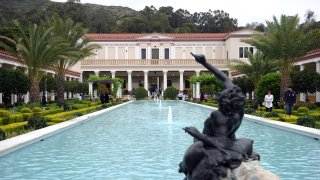 Visitors enjoy the garden at the Getty Villa Museum.