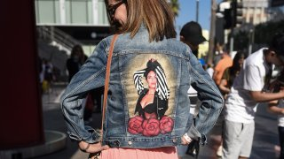 A Selena Quintanilla fan showing off the back of her jean jacket with Selena's image