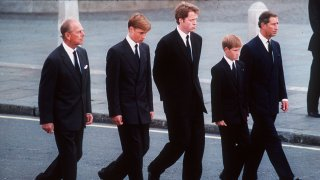 The Duke of Edinburgh, Prince William, Earl Spencer, Prince Harry and the Prince of Wales follow the coffin of Diana, Princess of Wales in September 1997