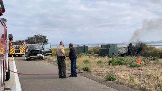Authorities respond to the scene of a car crash in Coronado on Sunday, April 25, 2021.