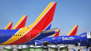 Southwest Airlines Boeing 737 MAX aircraft are parked on the tarmac after being grounded, at the Southern California Logistics Airport in Victorville, California on March 28, 2019.
