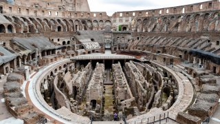 few visitors arrive for their tour of the ancient Colosseum, in Rome