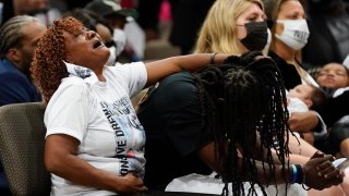 In this May 3, 2021, file photo, family members react during the funeral for Andrew Brown Jr. at Fountain of Life Church in Elizabeth City, North Carolina. Brown was fatally shot by Pasquotank County Sheriff deputies trying to serve a search warrant.