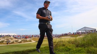 Phil Mickelson of the United States walks off the tenth tee during the third round of the 2021 PGA Championship at Kiawah Island Resort's Ocean Course.