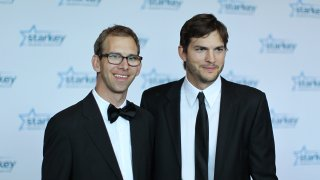 """Michael Kutcher and brother Ashton Kutcher walk the red carpet before the 2013 Starkey Hearing Foundation's """"So the World May Hear"""" Awards Gala on July 28, 2013 in St. Paul, Minnesota."""