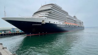 Holland America Line's Koningsdam ship arrives at the Port of San Diego's B Street Terminal on Wednesday, May 19, 2021 so dozens of its crew members can get their first dose of the COVID-19 vaccine.