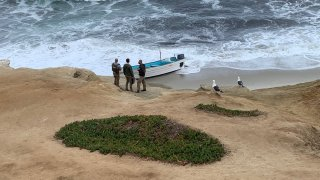 Authorities respond to one of a few scenes of a suspected human smuggling attempt off the waters of La Jolla on Thursday, May 20, 2021.