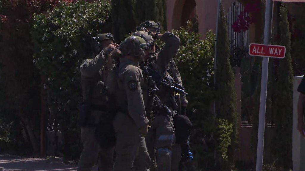 First responders in tactical gear respond to the scene of a standoff in Logan Heights on Friday, May 28, 2021.