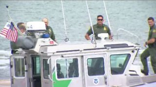 Border Patrol agents on boat as part of Marine Unit