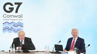 British Prime Minister Boris Johnson (L) and US President Joe Biden (R) attend a working session at the G7 summit in Carbis Bay, Cornwall on June 12, 2021. - G7 leaders from Canada, France, Germany, Italy, Japan, the UK and the United States meet this weekend for the first time in nearly two years, for three-day talks in Carbis Bay, Cornwall.