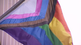 A Progress Pride Flag flies outside San Diego City Hall for the first time in honor of Pride Month.