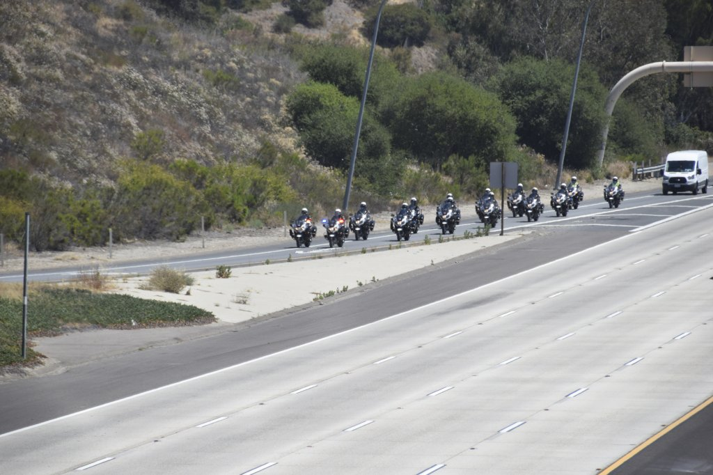 Police officers lead the way to the San Diego County Medical Examiner's Office on June 4, 2021 in a procession for two SDPD officers killed in a head-on collision in San Ysidro.