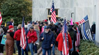 pro-Trump and anti-mask demonstrators hold a rally outside the Oregon State Capitol