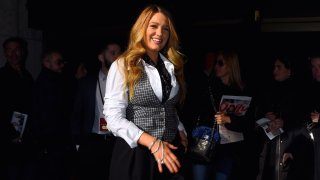 Blake Lively walks with other people in the background.