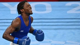 Keyshawn Davis celebrates after winning against France's Sofiane Oumiha after their men's light (57-63kg) preliminaries round at the Tokyo 2020 Olympic Games at the Kokugikan Arena in Tokyo on July 31, 2021.