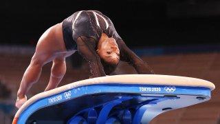 Simone Biles practices on vault