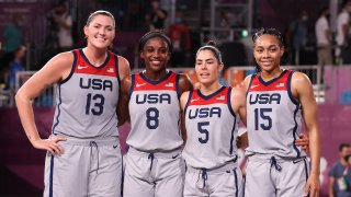 Stefanie Dolson, Jacquelyn Young, Kelsey Plum and Allisha Gray of Team United States pose for a portrait after winning the gold medal in the 3x3 Basketball competition on day five of the Tokyo 2020 Olympic Games at Aomi Urban Sports Park on July 28, 2021 in Tokyo, Japan.