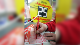 Photo illustration of a lottery ticket being filled out.