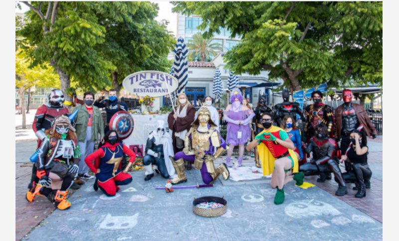 Comic-Con fans have created a shrine outside the Tin Fish restaurant to honor SDCC which was moved online due to the pandemic.
