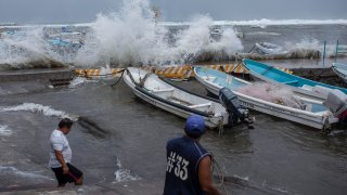 Fishermen remove their boats from the dock in the Veracruz state of Mexico