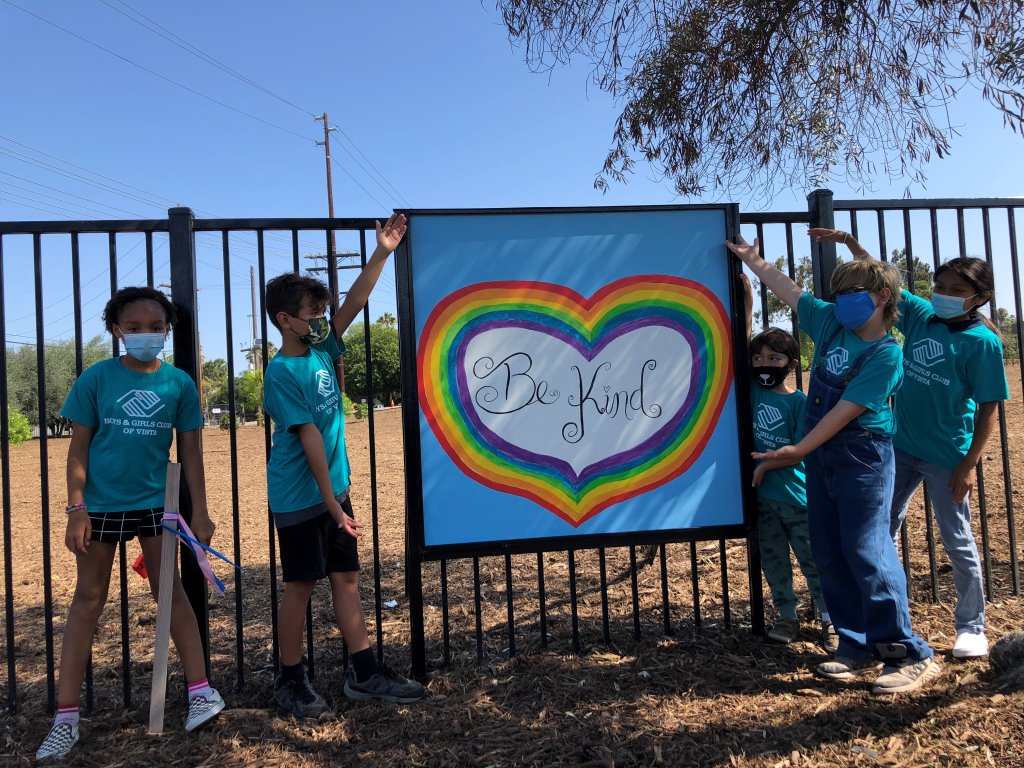 """""""Be Kind"""" reads a painting created by members of the Boys & Girls Club of Vista."""