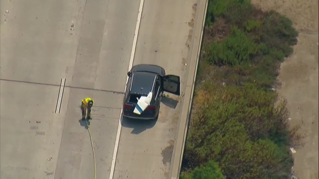 It appears a piece of the aircraft landed on a car on the freeway,