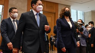 US Vice President Kamala Harris (R) walks with Vietnam's Prime Minister Pham Minh Chinh