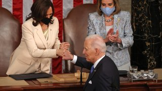 U.S. President Joe Biden fist-bumps Vice President Kamala Harris after he addressed a joint session of Congress with Speaker of the House Nancy Pelosi (D-CA) in the House chamber of the U.S. Capitol April 28, 2021 in Washington, DC.