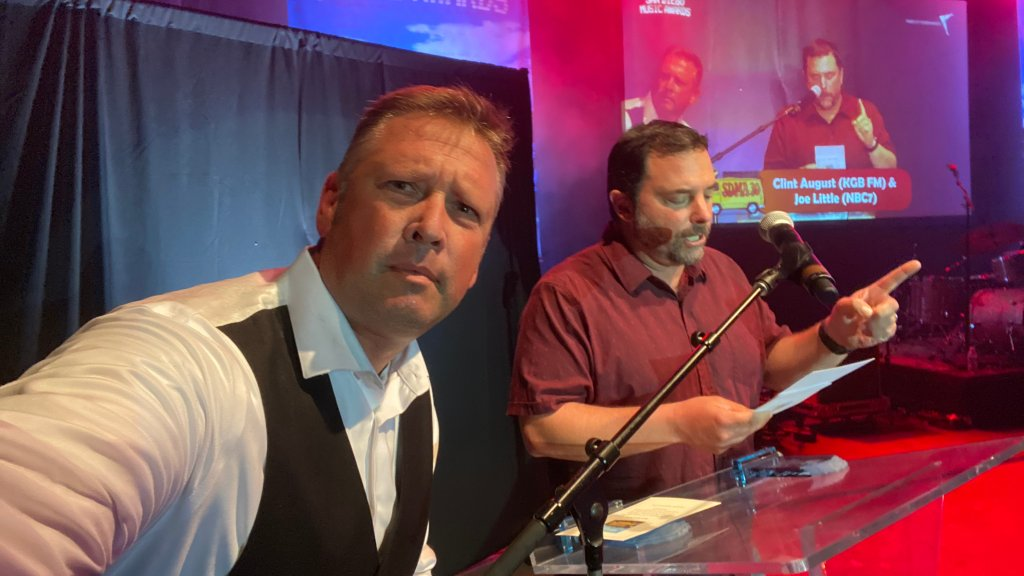 NBC 7's Joe Little at the podium with KGB FM's Clint August