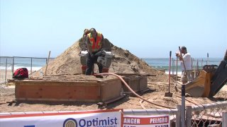 Sand sculpting artists are creating the largest sandcastle seen in Imperial Beach.
