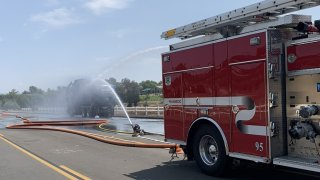 Cal Fire Riverside firefighters were hospitalized after a dump truck exploded in Temecula