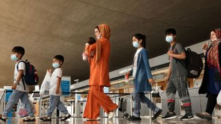Afghan refugees arrive at Dulles International Airport in Dulles, Virginia, August 31, 2021.