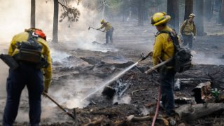 Firefighters putting out Caldor Fire hot spots