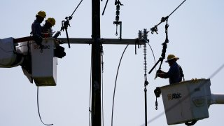 Crews work on power lines