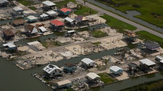 In this aerial photo, the remains of damaged homes are seen in the aftermath of Hurricane Ida, Monday, Sept. 6, 2021, in Grand Isle, La.