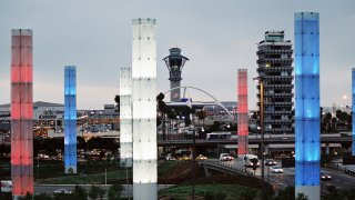 The pylons are lit up in red, white and blue for Labor Day at LAX.