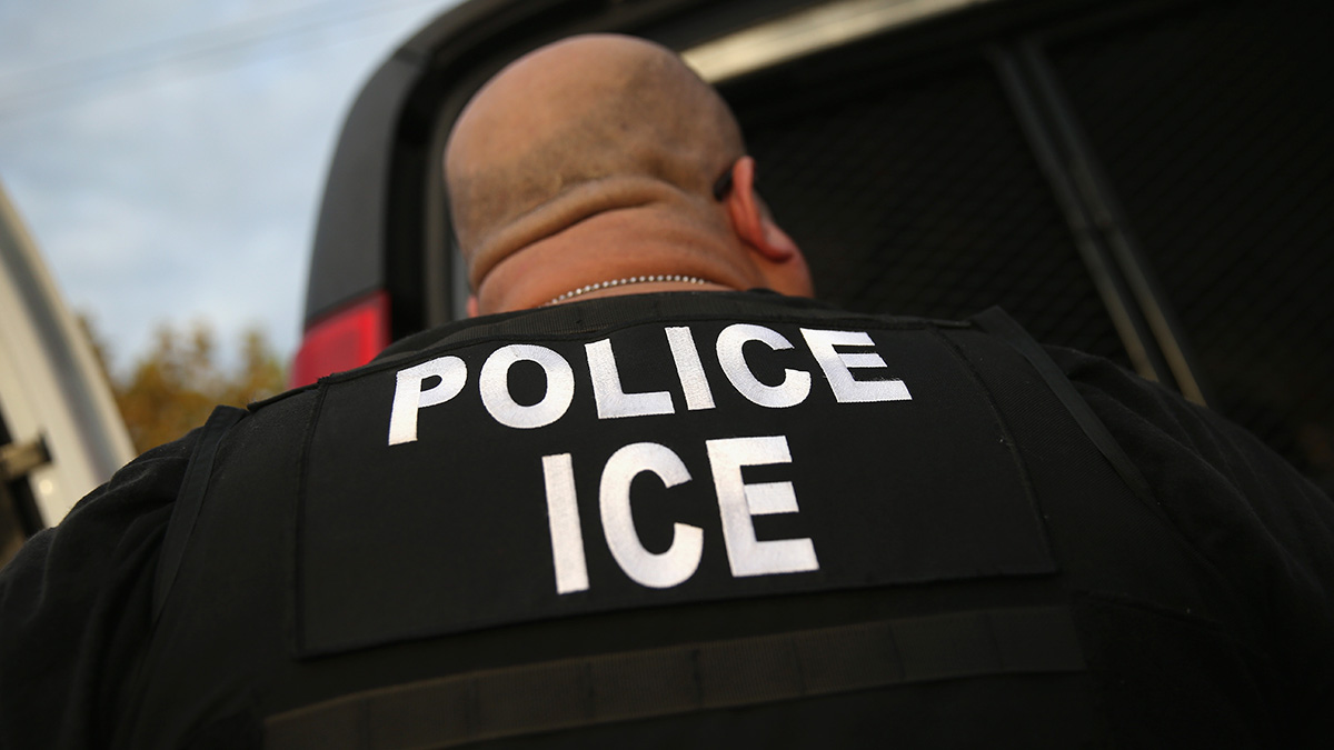 FILE - U.S. Immigration and Customs Enforcement (ICE), agents detain an immigrant on October 14, 2015 in Los Angeles, California.