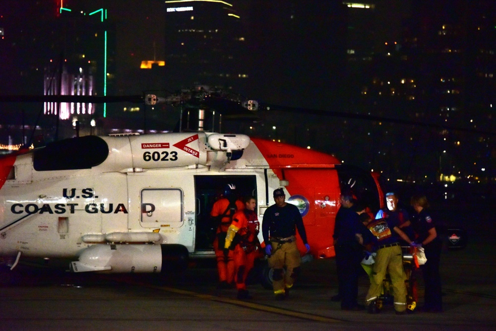 Coast Guardsmen and emergency medical services personnel assist a man who was injured in a boat collision off the coast of Imperial Beach on Oct. 26, 2018. The man was airlifted to San Diego and taken by an ambulance to UCSD Medical Center-Hill Crest. Photo by Fireman Taylor Bacon, USGC