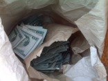 $100 Bills Thrown Onto Highway