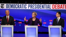 Debate Rivals Assail Warren as She Joins Democrats' Top Rank