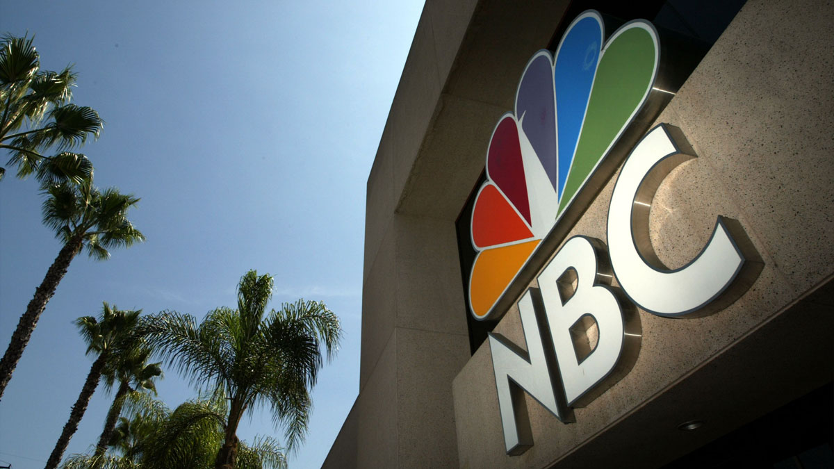 This Aug. 28, 2003, file photo shows the NBC peacock logo on the NBC Studios building in Burbank, California.