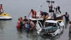 Dramatic Photos: Driver Crashes Into Lagoon
