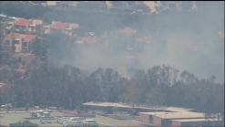 Brush Fire Burns in Canyon in University City